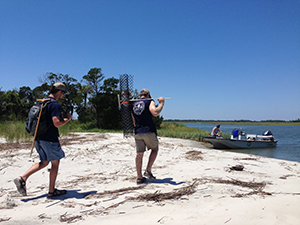 DNR staff return to boat after protecting nests on a remote beach