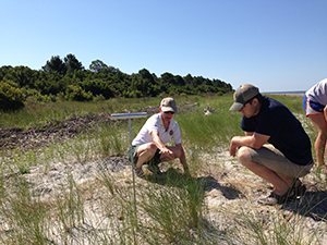 Charlotte Hope & DNR team member find a nest on a remote beach