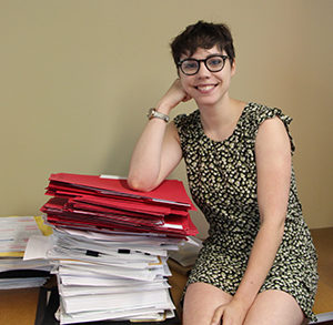 Erica Robak and her pile of contracts