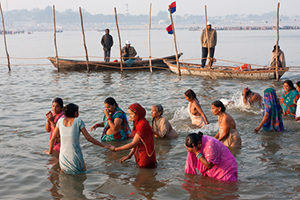 Women at the confluence of the Ganges and Yamuna during Kumbha Mela
