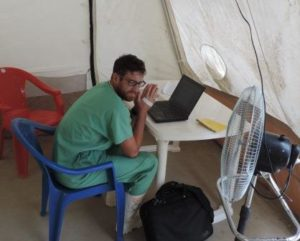 Temperatures reach 100°F inside full protective equipment. Here, Nick takes a brief break in the 90°F tent.