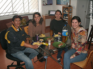 Pro Delphinus staff share a meal with Pedro, a fisherman, in the Pro Delphinus office