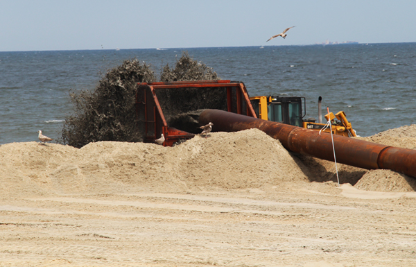 Dredging activities for beach nourishment after Superstorm Sandy
