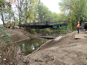 Refurbished rail car bridge replaces an undersized culvert that limited hydraulic connection to 20 acres of wetlands