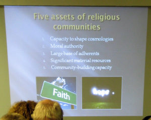 Joe Gunn shares a slide from a talk about faith communities in the climate struggle