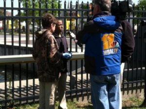 Students show Living Classrooms ATS to media